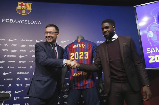 Umtiti signs his new deal. Image: PA Images.