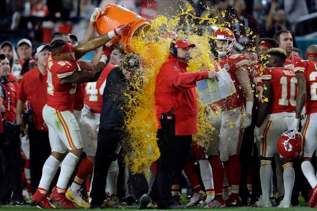 Chiefs head coach Andy Reid is covered in Gatorade by his players