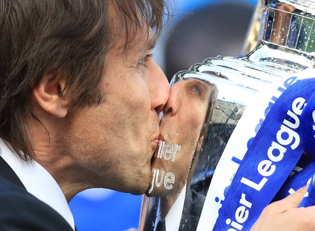 Conte kisses the trophy he wasn't really expected to win so soon. Image: PA Images