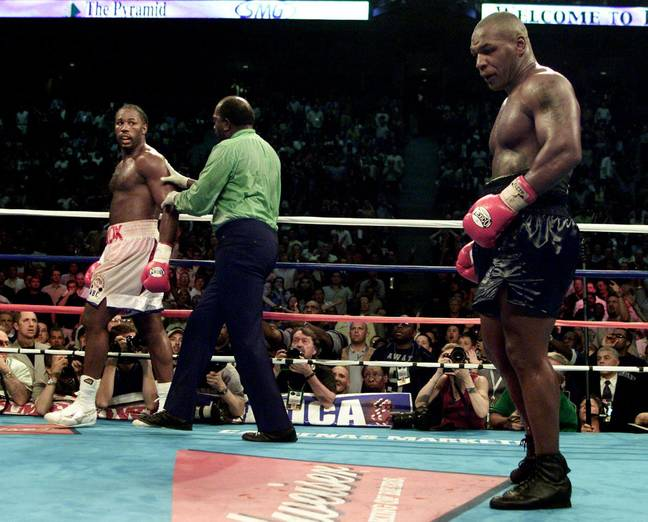 Lewis and Tyson during their fight. Image: PA Images