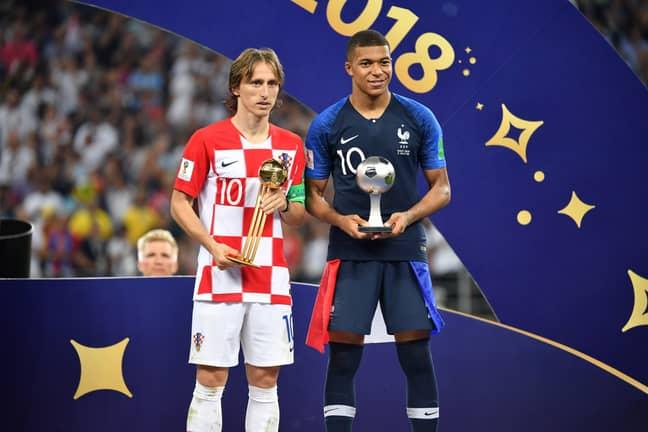 Modric alongside Mbappe. Image: PA