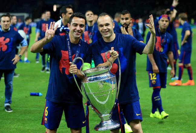 Xavi and Iniesta celebrate winning the Champions League. Image: PA