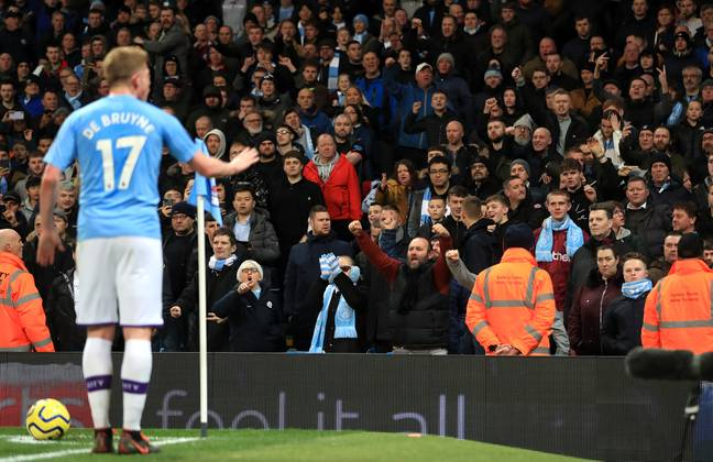 Kevin De Bruyne urging City fans to calm down. (Image Credit: PA)
