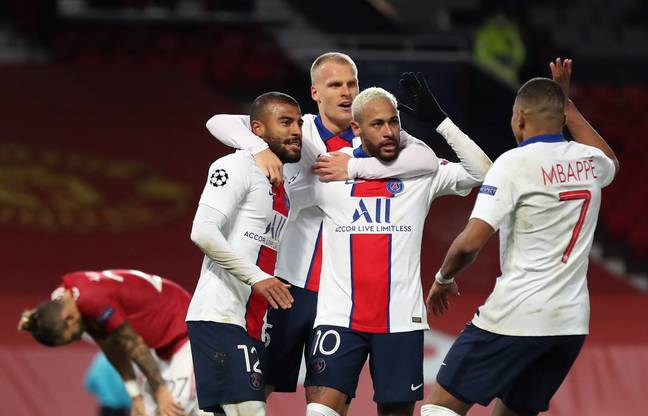 Neymar is surrounded by teammates as he celebrates his second of the night. Image: PA Images