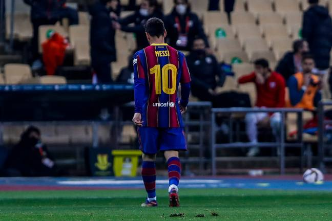 Messi walks off after getting sent off. Image: PA Images