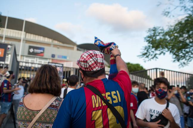 A protester wearing a Messi t-shirt during the demonstration outside the Camp Nou. Image: PA