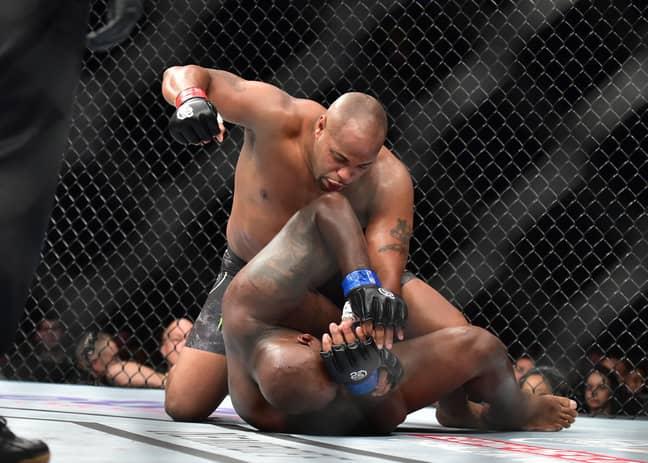 Daniel Cormier beating Derrick The Black Beast' Lewis. Credit: PA