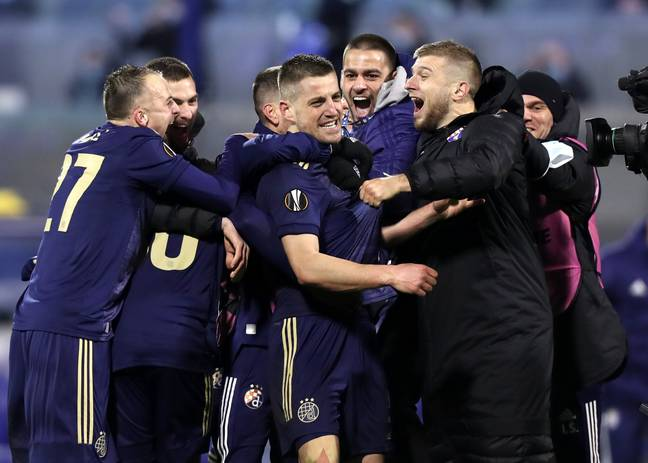 Zagreb celebrate their incredible comeback against Spurs. Image: PA Images