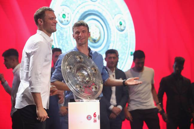Muller with his latest title. Image: PA Images