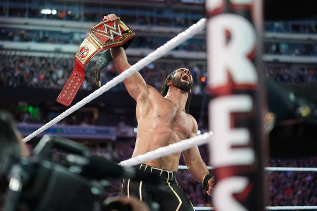 Seth Rollins leaves with his newly won Universal title. Image: PA Images