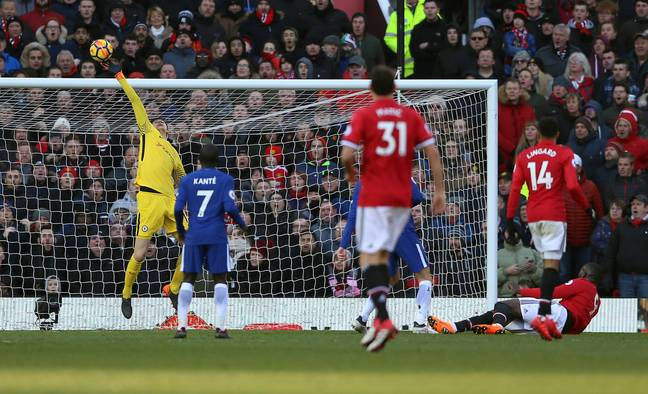 Courtois in action. Image: PA