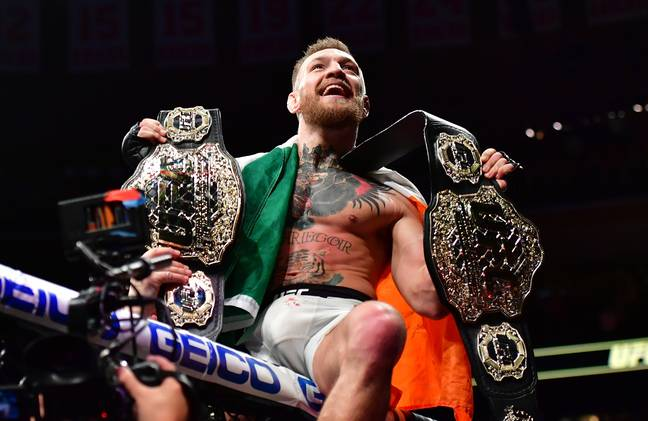 McGregor defeated Eddie Alvarez to become the first UFC fighter to hold two belts simultaneously. Credit: PA
