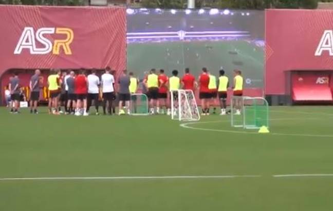 Roma players watching the drone footage on the new screen. Image: Twitter