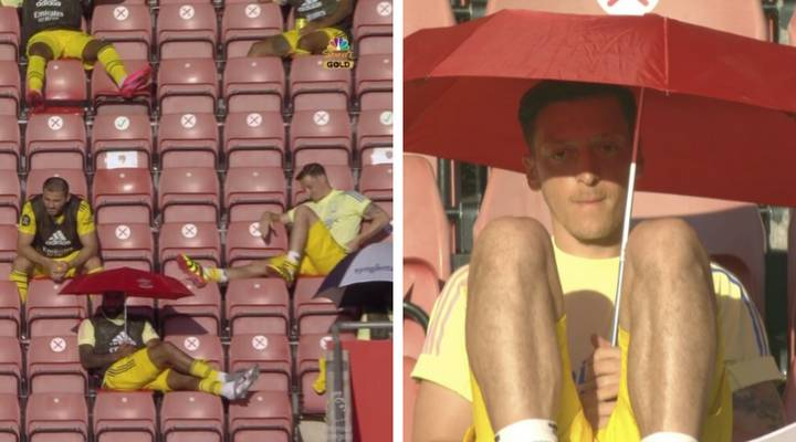Mesut Ozil & Alexandre Lacazette Caught Casually Relaxing With Parasols During Southampton Vs Arsenal