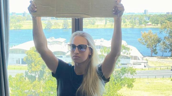 Quarantined Tennis Player Yulia Putintseva Holds Up Sign Saying 'We Need Fresh Air To Breathe'