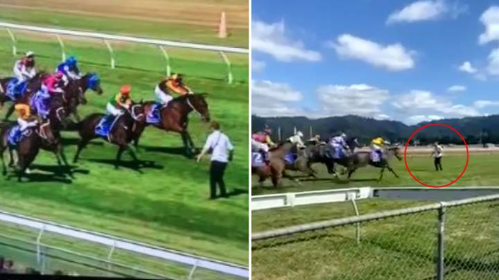 Terrifying Footage Shows Man Risking His Life By Running On Track Towards Horses During Race