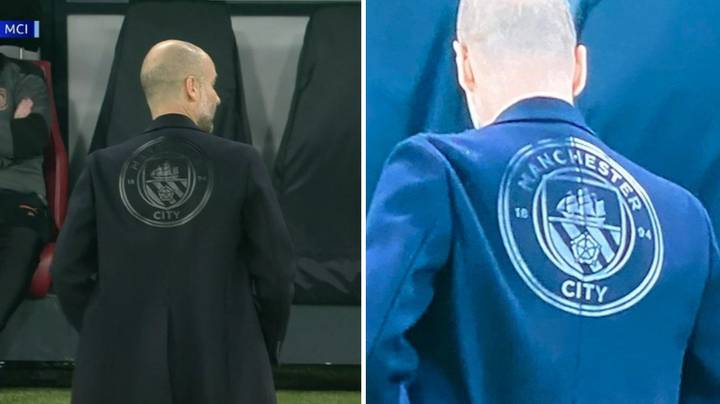 Pep Guardiola's New Coat Has A MASSIVE Manchester City Crest On The Back