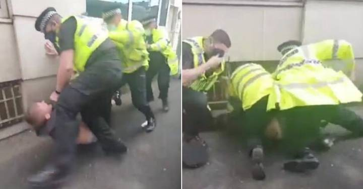Police Officer 'Repeatedly Punches' Manchester United Fan As He Lies On Ground