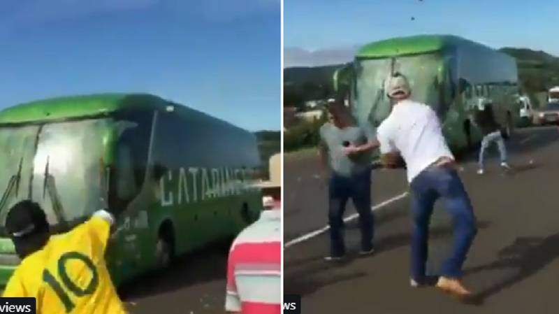 Brazil Fans 'Welcome Back' Players By Throwing Stones At Team Bus