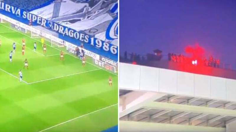 Porto Fans Climb Onto The Roof Of The Stadium To Watch The Game
