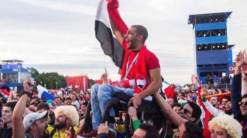 Mexican And Colombian Fans Lift A Disabled Egyptian Supporter So He Can Watch The Game