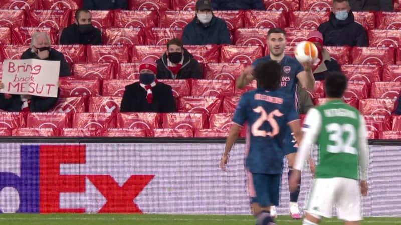 Arsenal Fan Holds Up 'Bring Back Mesut' Sign At Emirates Stadium