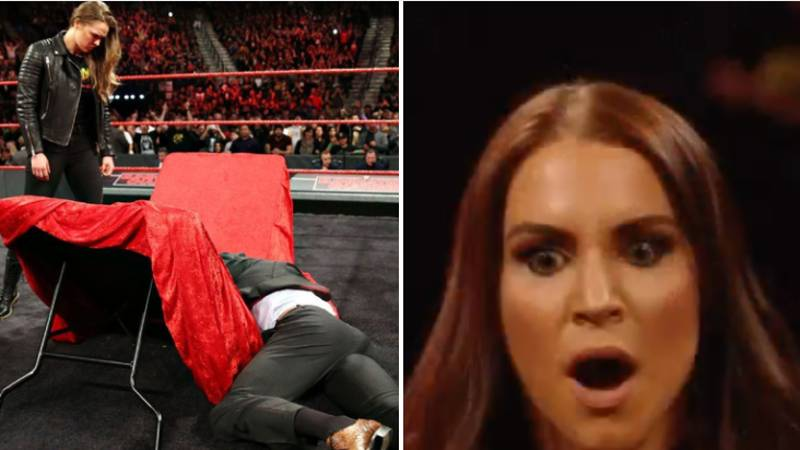 Ronda Rousey Marks WWE Contract Signing By Putting Triple H Through A Table